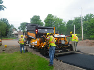 Asphalt supplier paving a drveway in Truro, Nova Scotia