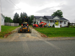 preparing a driveway with gravel, before asphalt application